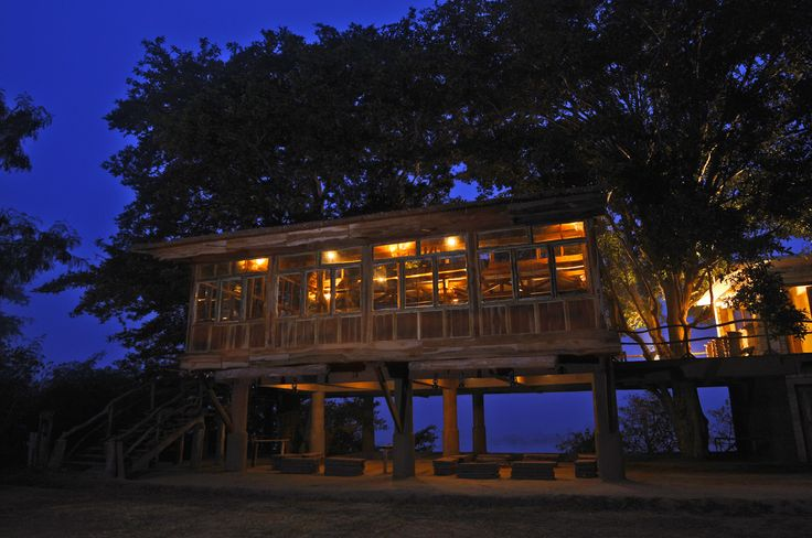The Machaan Restaurant Machaan where the meals are served. Popularly known as the tree house over looks the Ken river.