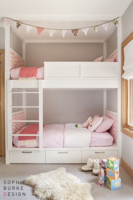 Pink and gray girls' room with white lacquered bunk beds dressed with white and pink headboard and ...