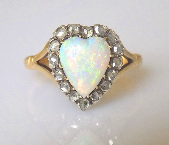 Antique Victorian c.1890-1900 18 carat gold Heart ring. The middle heart shaped Australian Opal surounded by 16 Rose cut Diamonds in solid Silver setting on a split shoulders 18 carat Gold shank.
