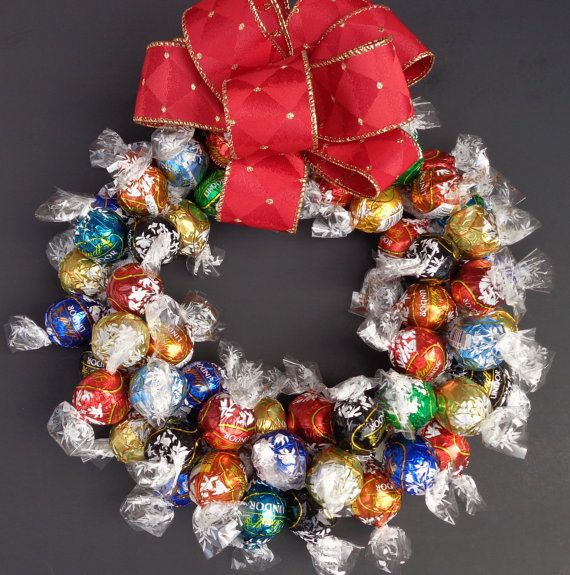 MOST POPULAR SHOP GIFT IN 2015 - Chocolate Lover Truffle Candy Wreath Edible Gourmet Centerpiece Unique Client Christmas Hostess Gift - Made entirely of chocolate truffles, this wreath makes a perfect decoration, centerpiece, or gift for the chocolate lover. Mixture of rich, creamy chocolate truffles. All include include dark, white, and milk chocolate flavors with two other flavors added to the mix. These flavors may include dark chocolate mint, pumpkin spice, caramel, orange, almond…