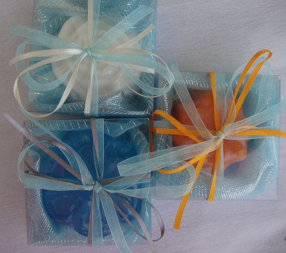 Handmade Bomboniere / Wedding Favors / Bridal Shower Favors / Engagement Gifts / Wedding Party Gifts / Wedding Guest Gifts, each containing a luxury scented soap in a Light Blue Azure -Aquamarine organza cloth and ribbons matching the soap's color. This very elegant, stylish gift is Ideal for a Wedding by the sea. Can be combined with a relevant Scented Soap Cake.