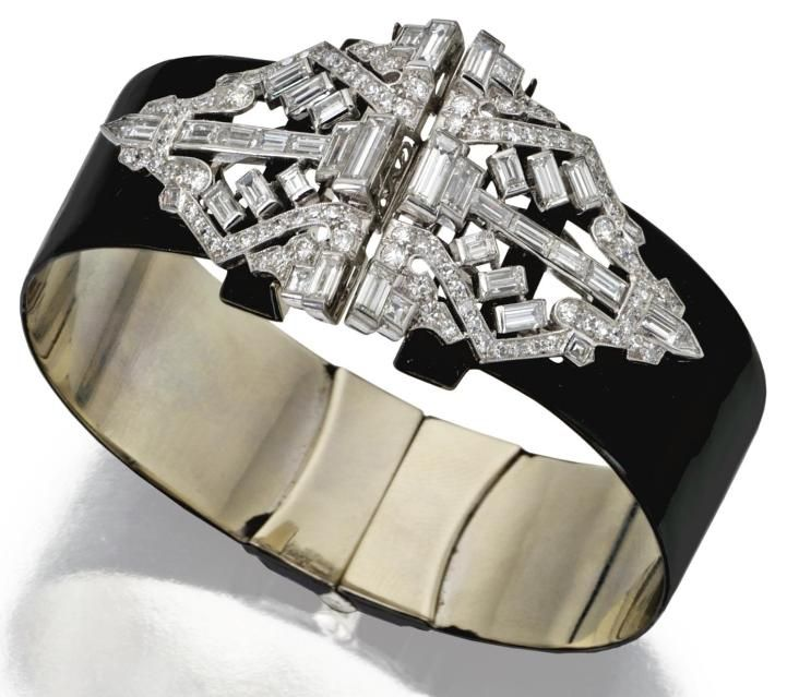 Diamond and enamel clip/bangle-bracelet combination, circa 1930. The pair of clips set with baguette, triangular-shaped, old European-cut and single-cut diamonds weighing a total of approximately 5.00 carats, mounted in platinum.