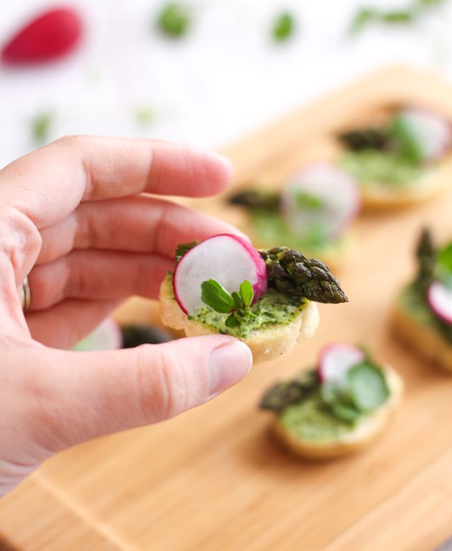 Watercress and goat's cheese crostini with asparagus and radishes - perfect little bite-sized canapés for a summer party.