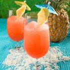 Bahama Mama  1/2 oz Rum  1/2 oz coconut - flavored rum  1/2 fluid oz grenadine syrup (YUM!)  1 oz orange juice  1 oz pineapple juice  1 cup ice