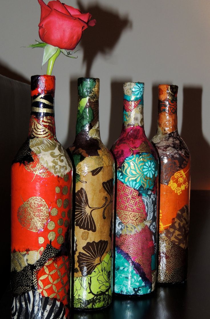 Modge Podge scrap book paper onto an old bottle (of any size/shape) & now you have a Beautiful Piece of Art.