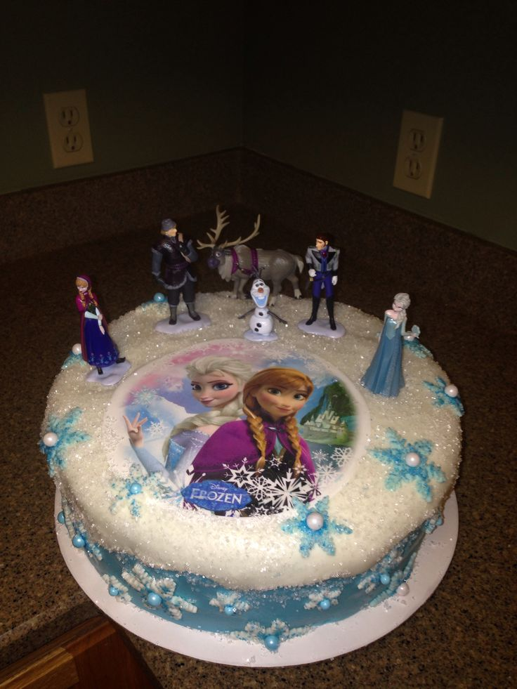 Disney Frozen Cake... We'll have something just like this, since my daughter wants an ice cream cake with the same picture of the sisters on it, plus the figurines!