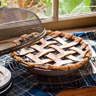 Pure maple syrup gives the fruit filling rich flavor in this healthy blueberry pie recipe.