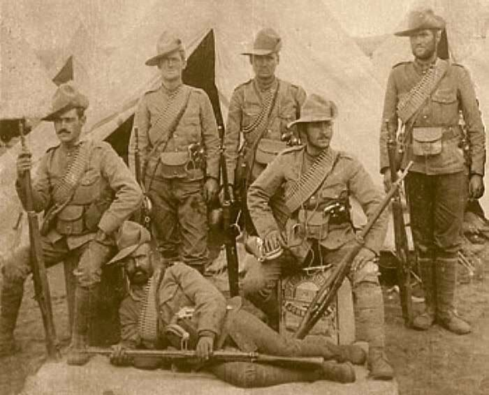 Canadians in South Africa (Boer War, 1899-1902). Buglers, 2nd Battalion.Royal Canadian Regiment, armed with .303 Magazine Lee-Enfield rifle and .45 Colt Model 1878 Double Action revolvers -