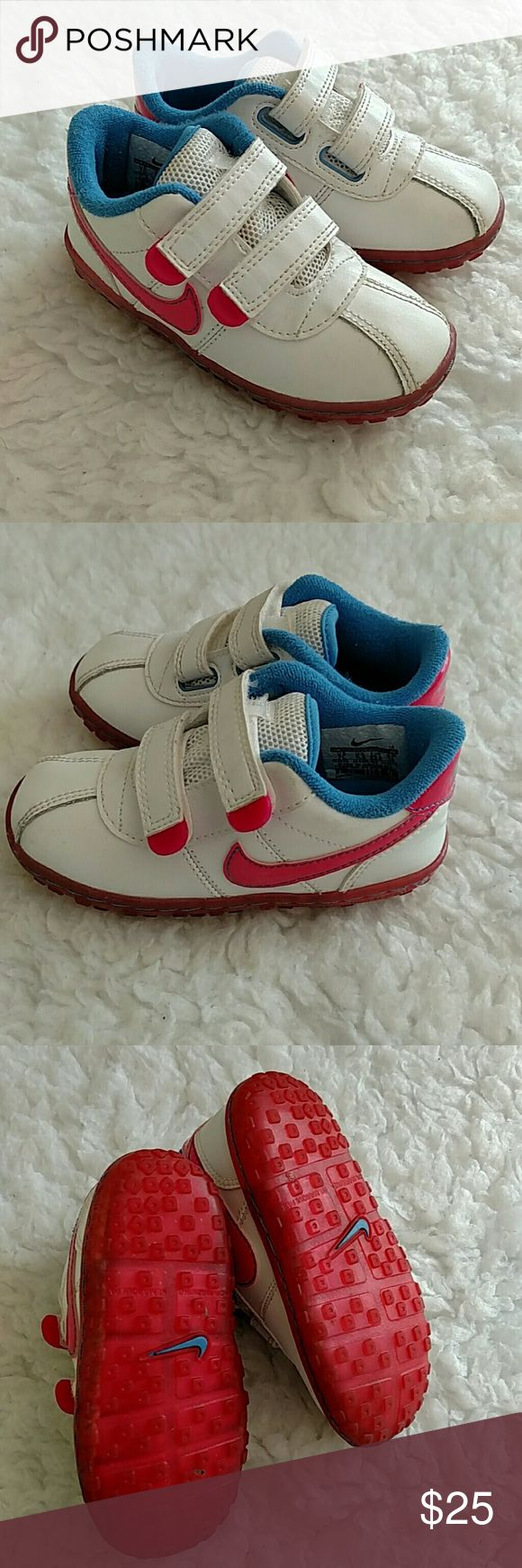 Nike white, pink & blue double Velcro strap shoes Like new. I'm great condition. White with the Pink nike swoosh. Couple Velcro straps for little ones learning to put on shoes!! Nike Shoes Sneakers