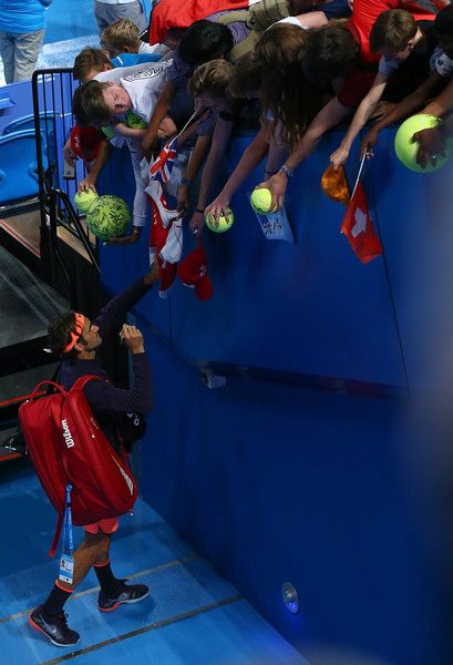 Roger Federer Photos Photos - Roger Federer of Switzerland signs autographs for spectators after winning the mixed doubles match partnered with Belinda Bencic against Heather Watson and Dan Evans of Great Britain on day two of the 2017 Hopman Cup at Perth Arena on January 2, 2017 in Perth, Australia. - 2017 Hopman Cup - Day 2