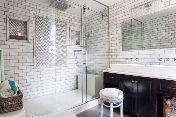 moswern walk in shower with subway tile and glass doors