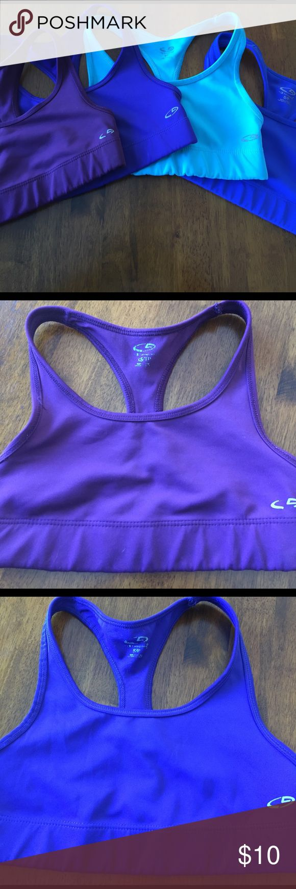 Set of 4 Champion sports bras Set of 4 Champion sports bras. 2 shades of purple and 2 shades of blue. No rips or stains. Gently worn. 3 are size small and one is an extra Small. Champion Other