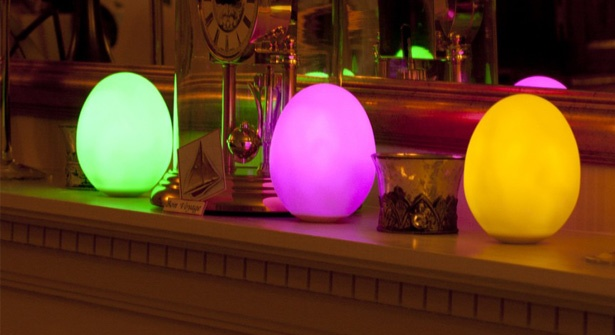 Illuminate your home with the soft, multicoloured glow of three LED egg-shaped lights. Slowly fading through all the colours of the rainbow, these rechargeable lights make stunning centrepieces