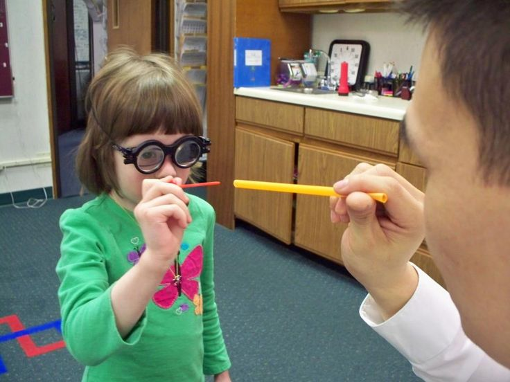 "Caroline, who has amblyopia, is seen here working on an advanced office-based vision therapy technique with Dr. Tuan involving prisms and eye-hand coordination (""Piercing a Straw""). Her treatment includes many other techniques, based on the latest neuroscience that helps her rapidly develop her vision through game-based visually stimulating activities. Caroline also does home-based activities with..."