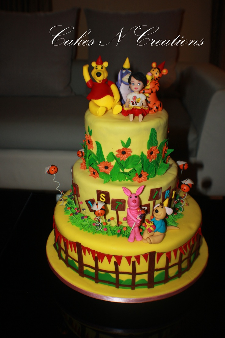 ... cake with Tigger, eeyor,piglet and roo and the little birthday girl