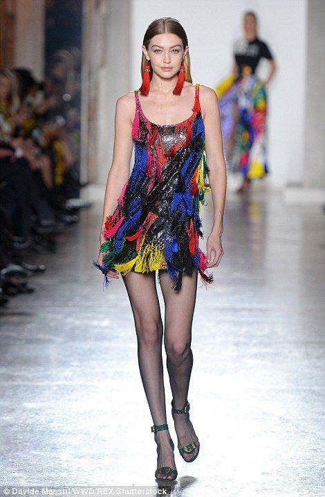Rainbow-tastic: Gigi also donned a multi-coloured mini-dress covered in tassels...