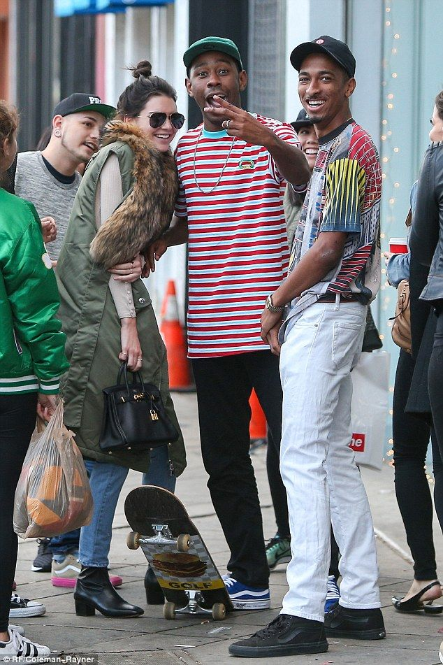 Social hour! Kendall Jenner grinned with glee as she hung out with Odd Future members Tyler, The Creator and Travis 'Taco' Bennett in Hollywood on Monday