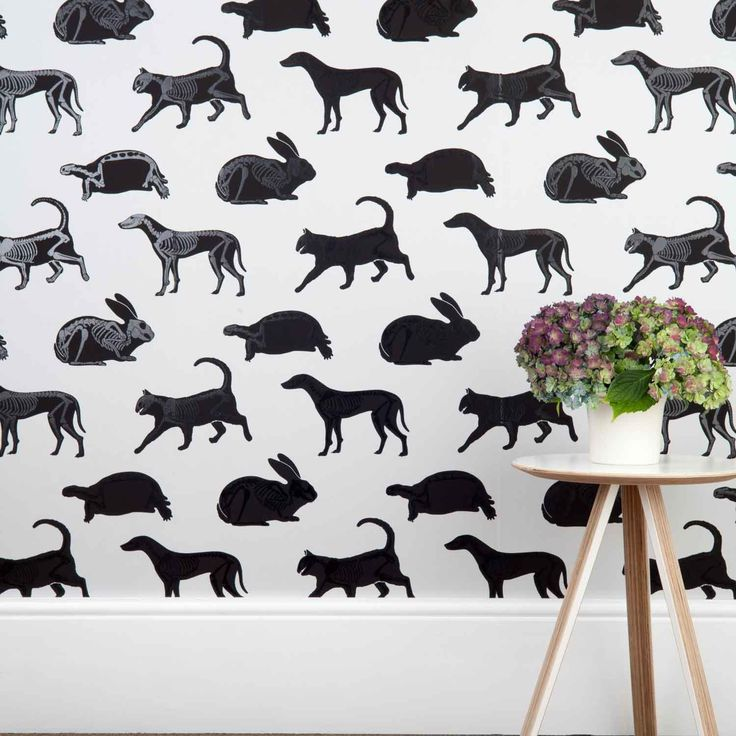 'Animal Magic' wallpaper, solid black silhouettes, but when the light hits it you can see skeletons.