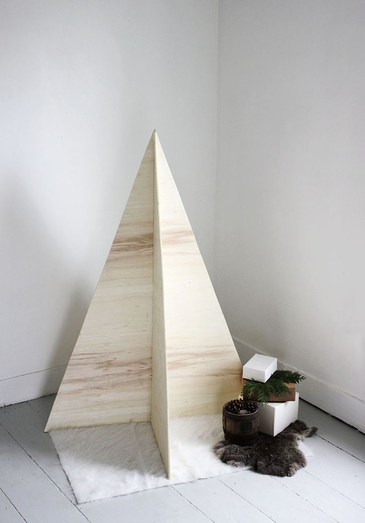 This minimal plywood Christmas tree is a perfect, apartment-friendly option for the holidays! And it folds up and stores easily! - I think this would be cute with lights and a star!