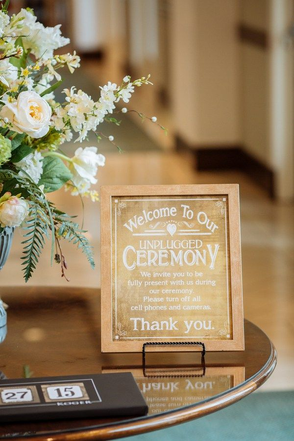 Welcome sign - Jillia and Steve's Outdoor Spring Lunch Wedding at The Palmetto…
