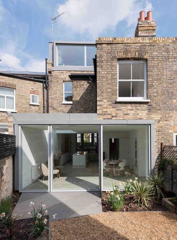 Simple extension, with glass sliding doors.