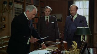 Golden Gun |  a meeting in M's office, where his boss M (Bernard Lee)  is accompanied by Chief of Staff Bill Tanner (Michael Goodliffe) and Colthorpe (James Cossins).