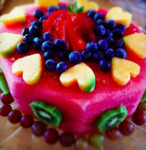 Awesome idea for a birthday cake: all watermelon (for the base) and other yummy fruits for the decorations!