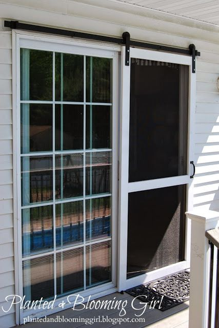 When this blogger bought her home she intended to replace the back door with a wood one. After realizing that the rustic look would clash with her colonial-style home, she opted to hang a screen door using sliding hardware instead.