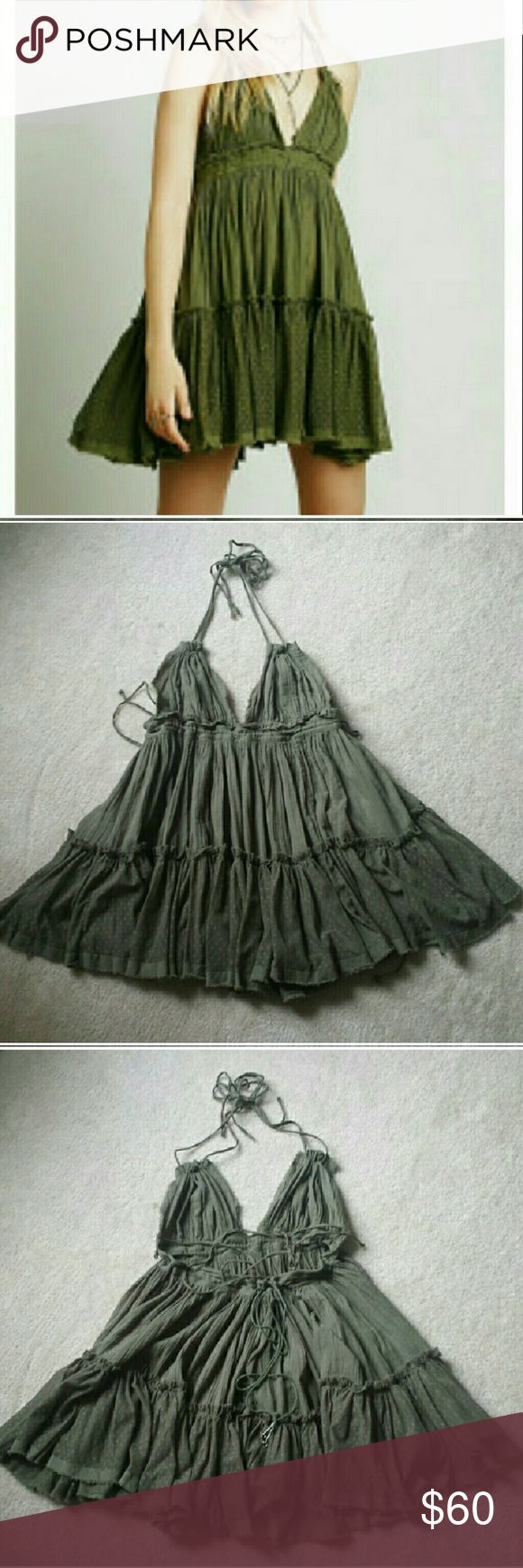 Free People 100 Degrees Dress Color is light army. Ties at neck and back. Tie under bust has small bells on the end. Dotted mesh skirt and raw edge fabric hem. In like new condition. Free People Dresses
