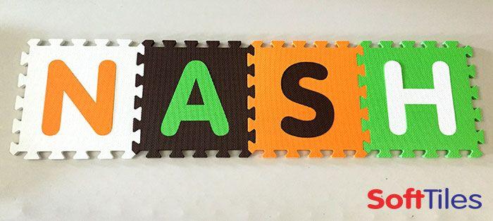 Nash in White, Orange, Brown, and Lime SoftTiles 1x1 Interlocking Foam Mats.