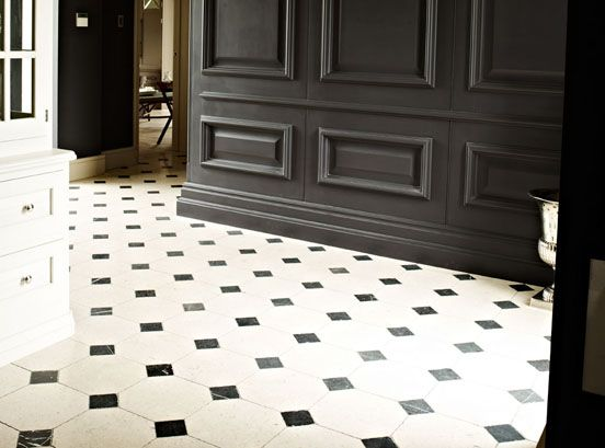 a classic hand-selected Jerusalem Ivory distressed octagon limestone with Nero Marquina black marble inserts.