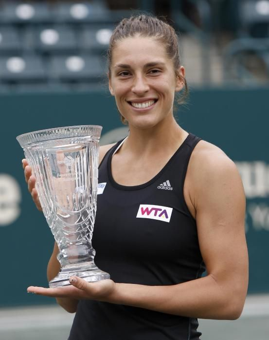 Andrea Petkovic, of Germany, holds the trophy after defeating Jana Cepelova, of Slovakia, in two sets during the Family Circle Cup tennis tournament final in Charleston, S.C., Sunday, April 6, 2014. Petkovic won 7-5, 6-2 to win the championship. #WTA #Petkovic #FCC2014