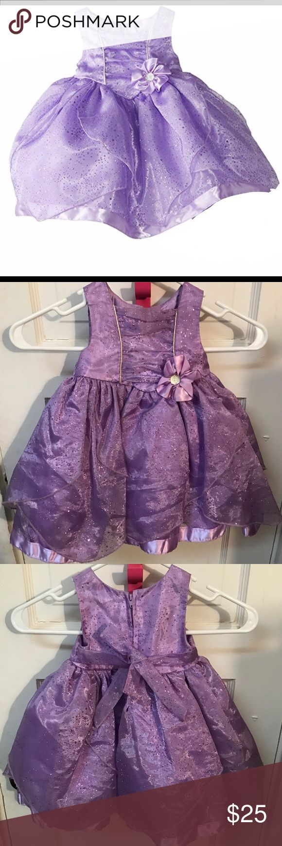 Disney Princess Dress This is an absolutely beautiful purple princess dress from Disney. This is for a size 18 months, but unfortunately was too small for my daughter. It's 100% polyester. My loss is your gain 😭. This dress really does look and feel like a princess dress. It's so stunning in real life, good for birthday parties, weddings, and even Easter. Dresses