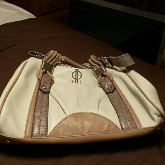 Jennifer Looez shoulder purse Purse is cream color with taupe straps. Three compartments, two zipper and one snap. Jennifer Lopez Bags
