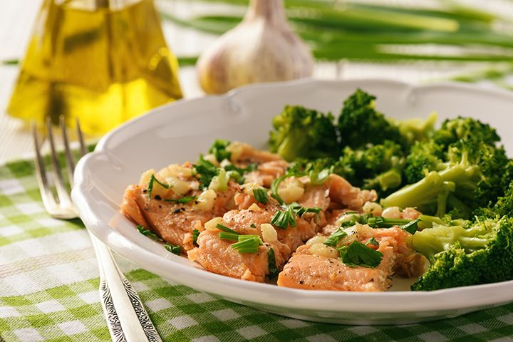 Joy Bauer's Baked Fish With Broccoli and Sweet Potato : Enjoy a delicious and protein-packed dinner with this simple baked fish recipe.