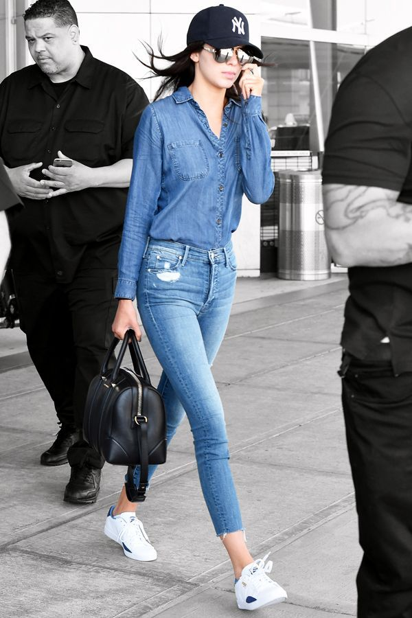 Kendall Jenner was spotted at JFK wearing double denim, Puma sneakers, and a baseball hat. Most stylish Yankees fan, hands down.