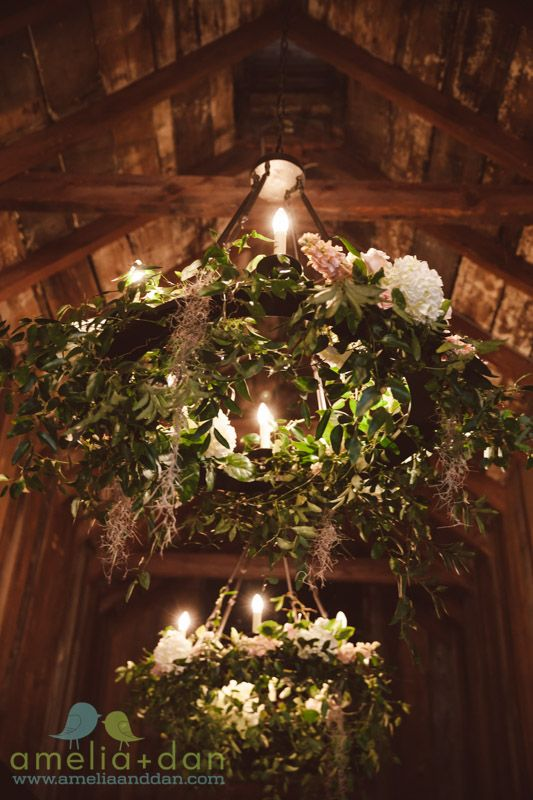 Magnolia Plantation Carriage House Wedding Charleston, SC. Magnolia leaves and floral make rustic chandeliers chic.