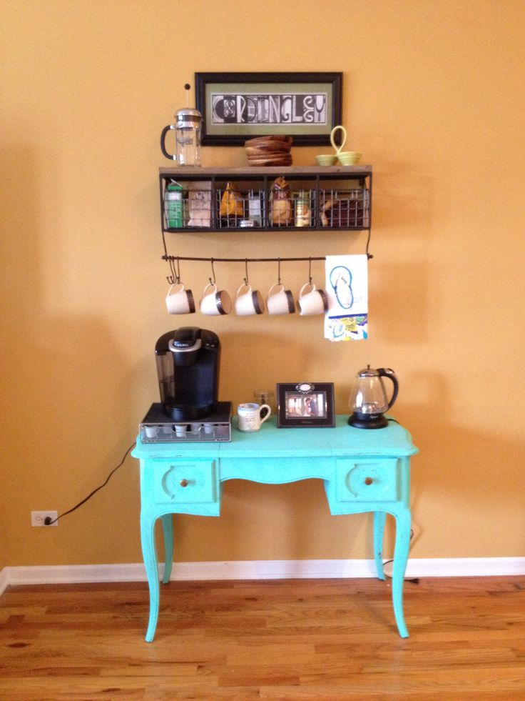 "Update (we moved!): http://www.pinterest.com/pin/144115256801656397/  Our new coffee bar! My great aunt left me a vanity I used to play with when I was little and I've been dying to do something fun with it. Thanks to my awesome husband for repainting the piece - you know, after having a lesson on the meaning of ""shabby chic"" :) Must give credit to this blogger who inspired the idea. http://ournavylife.blogspot.com/2012/07/diy-coffee-bar.html?m=1"