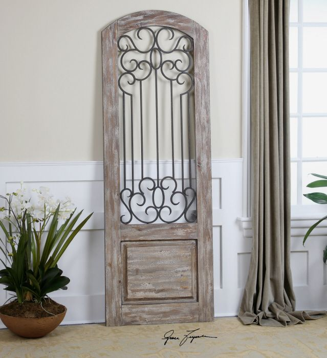 this decorative wall decor is distressed solid wood accented with a taupe gray wash and hand forged metal details finished in an aged rust bronze