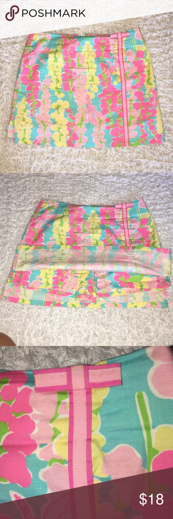 Lilly Pulitzer Lenore Skirt - Dragon Fly Great for summer! This pattern is to die for, bright and fun!  Lenore Skort from Lilly Pulitzer Good condition - no tag - small spot marked in picture with arrow.   97% cotton, 3% spandex   Machine wash cold  No bleach Tumble dry low or hang to dry. Lilly Pulitzer Skirts Mini