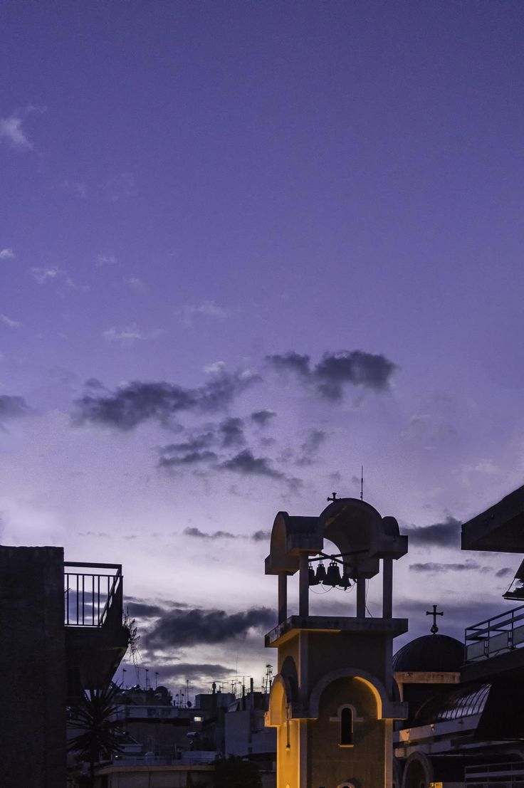 The morning twilight is painted purple behind a belfry. This purple morning has not been colour corrected; that was the actual colour of the sky.