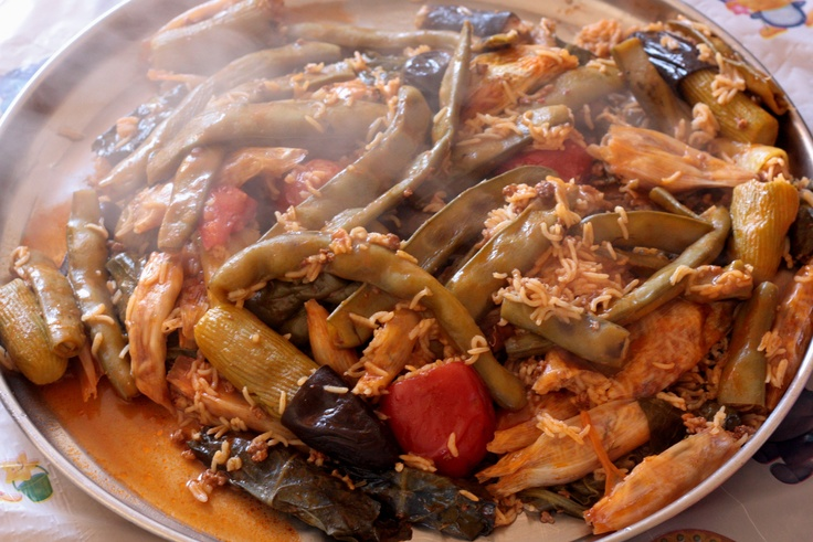 Dolma is a favorite dish in Kurdistan made from stuffed eggplant, bell peppers, onions, squash and tomatoes.