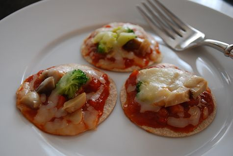 Mini pizzas have quickly become a dinnertime staple at our house. They're just so cute and easy to make, and Elise can help with the recipe. The final mini pizzas are about 2-1/2 in diameter - perfect for kids to handle on their own or for adults to pop in their mouths amuse-bouche-like. I usually