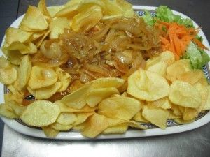 Bacalhau with pan fried potatoes & cartelized onions.