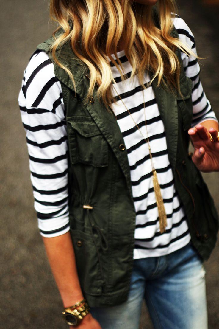 Anorak vest, black & white stripe shirt, boyfriend jeans, black cutout booties, gold tassel necklace