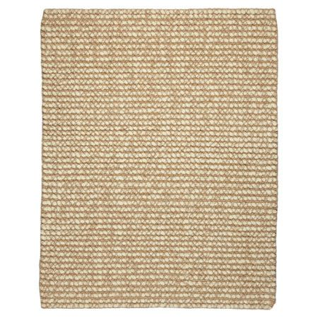 Anchor your living room seating group or define space in the den with this hand-loomed rug, crafted from jute and wool for natural appeal.    ...