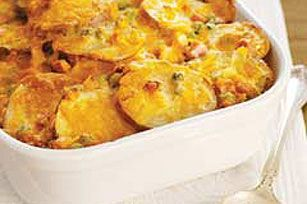 """Easy Cheesy Scalloped Potatoes recipe. I""""m cooking them right now. I added some garlic powder and some parsley for more color. Yummy I'll let u know how it turned out."""