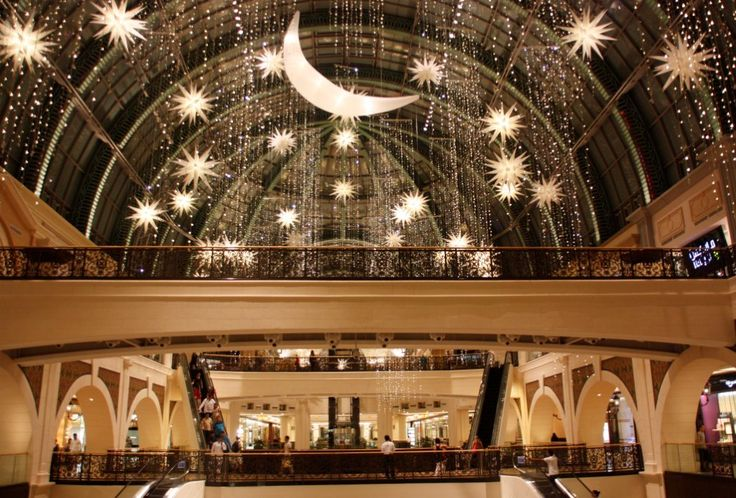 A scene from the Mall of the Emirates (above) shows the traditional symbol of Ramadan, the crescent moon surrounded by stars.