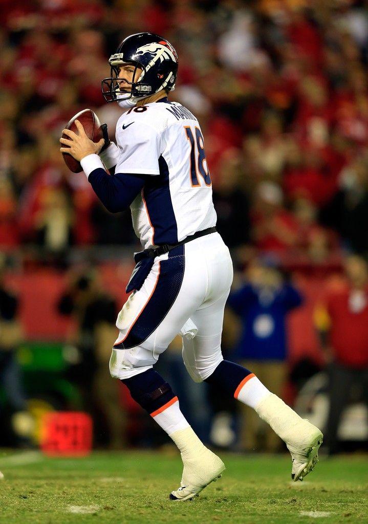 Quarterback Peyton Manning #18 of the Denver Broncos passes during the game against the Kansas City Chiefs at Arrowhead Stadium on December 1, 2013 in Kansas City, Missouri.