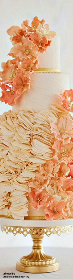 Gorgeous weddind cake with orange details.